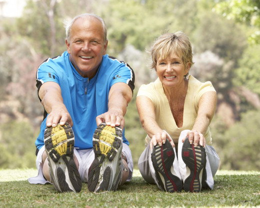 Health and Happy Male and Female Exercising