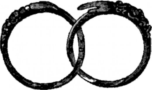 Two parts of a gimmel ring that attaches to one another.