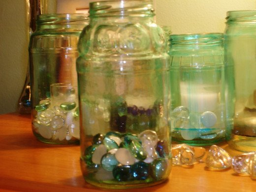 The jar in the forefront had extra water added to the paint while the jar just to the right had less water added and you can see a few streaks.  Without any water, you would see a lot more.  Again just add more food coloring for a darker paint.