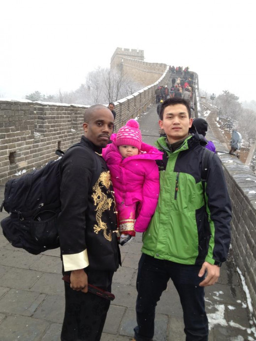 Example of an unknown Chinese man asking my husband and daughter for a picture on the Great Wall.