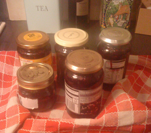 Five assorted jars of wild berry jam.