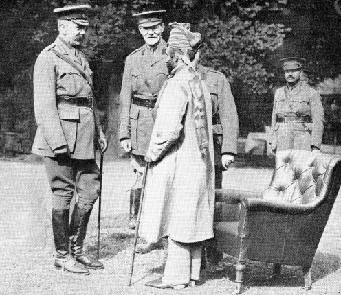 Lord Kitchener, visiting Brighton, talking with Indian hero, Subadar Mir-Dast, 55th Coke's Rifles, who gained the V.C. and Indian Order of Merit. With Lord Kitchener is Col. J. N. Macleod, Officer Commanding hospital for wounded Indian soldiers.