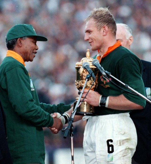 Mandela shaking  Francois Pienaar; the Captain of the Sprinbok's hand.