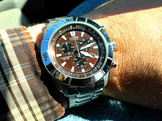 This inexpensive watch from Citizen not only has eco-drive so it never needs a battery, but also has an eyecatching design as well. It's one of my personal favorites.