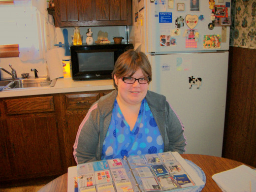 My friend Hannah shows me her method of organizing her coupons using a baseball collecters  book