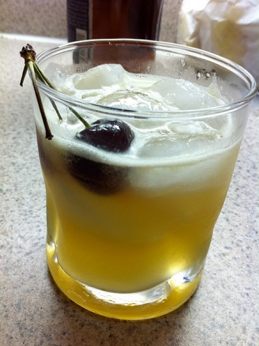 A good whiskey sour recipe will produce a delicious, frothy whiskey sour. This one is garnished with a large, garnet colored cherry