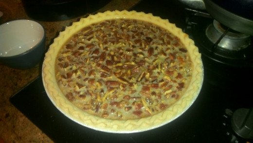 pie after pouring in filling, but before topping off with pecans