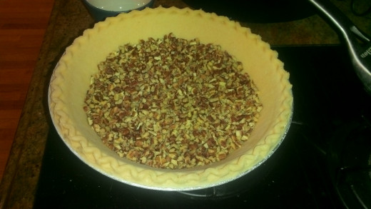 pour finely chopped pecans into the bottom of the pie crust.  After pouring in the pie filling, these will mingle and float around and help with overall consistency of the pie.