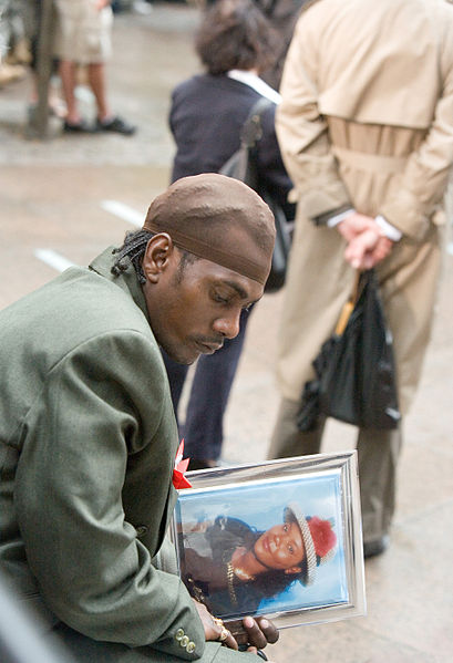 Ground Zero, NY, September 11, 2007 -- Ground Zero mourner reflects on the death of a loved one during 9-11 Memorial Service. Andrea Booher/FEMA