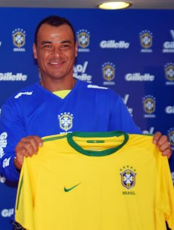 Cafu holding the five-times world champion jersey