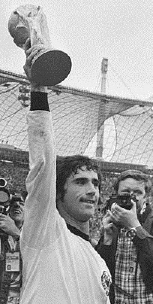 Gerd Müller with his beloved 1974 World Cup trophy