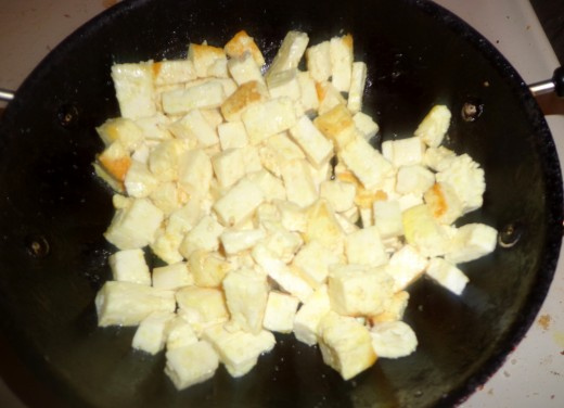 Paneer cubes are getting fried in butter