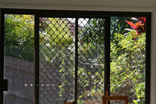 No longer able to cope with a large backyard and stairs, my daughter now has security screens and a tiny courtyard instead - more suited to her disability.