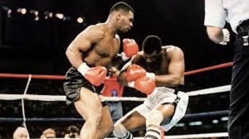 Mike Tyson flattened Michael Spinks in only 91 seconds in their heavyweight title match.