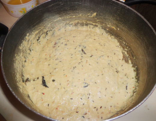 Ground paste is added inside the pan