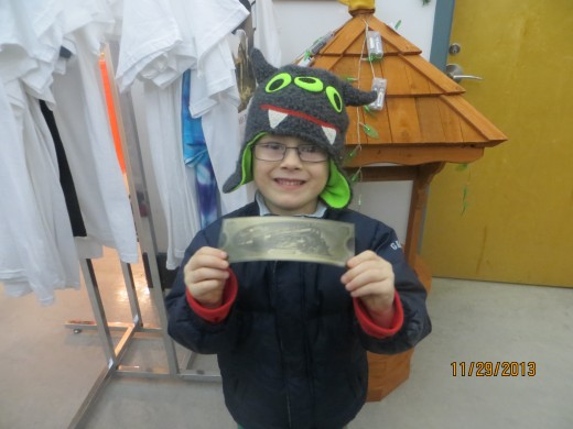 "Here's my Grandson all excited with his ""golden ticket"" for the Polar Express!"
