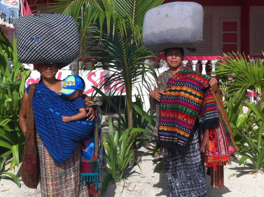 Mayan women travel longs distances every day, under incredible loads.  They carry amazing blankets like the ones over their shoulders and do business where ever they find it.