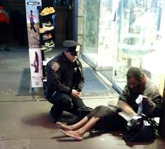 Officer sees homeless man without any shoes.  He then goes to an open sneaker store and purchases sneakers for the man.