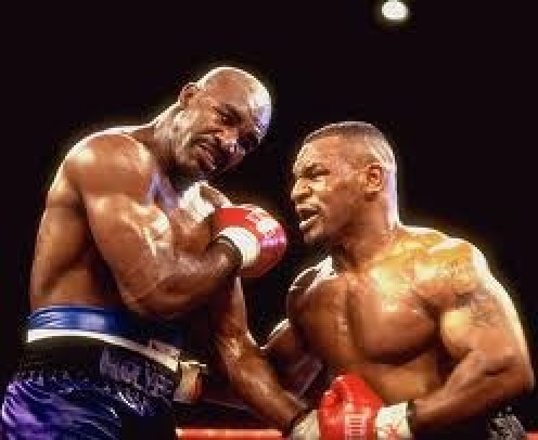 Evander Holyfield beat Mike Tyson twice with the first win making Holyfield a three time heavyweight champion.