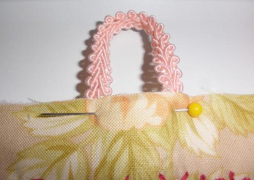 Attach ribbon to each piece of birthday calendar.