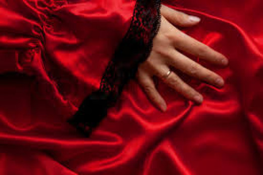 Nothings says allure more than red. It's the MOST ALLURING of all colors.It tempts & seduces It arouses & excites.It's warmth,heat, hotness,fire, desire, lust, & want.It's appreciating & revelling in one's physicality & carnality.