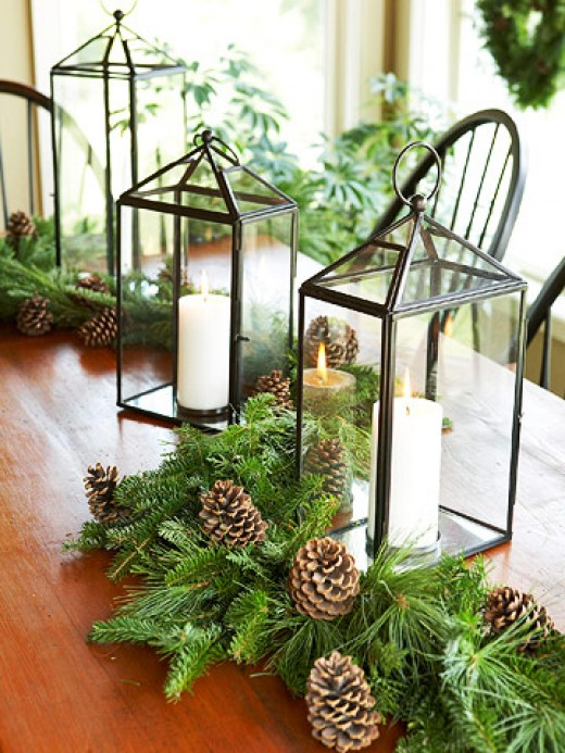 Combine pine cones, greenery and candles for a festive appearance