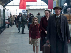 Liesel and Rosa accompany Hans to the train where he will leave for German army duty in Essen.