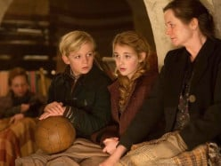 Rudy, Liesel and Rosa wait out the night in the bomb  shelter where Liesel tells a story to entertain and comfort the residents.