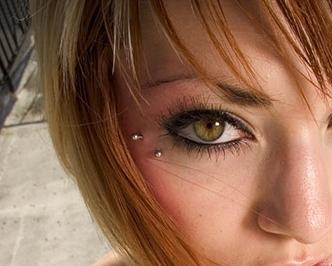 Anti-eyebrow piercings look like tears below the eyes