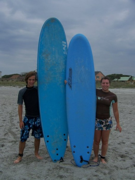 Author & her brother, getting ready to surf in Charleston, South Carolina.