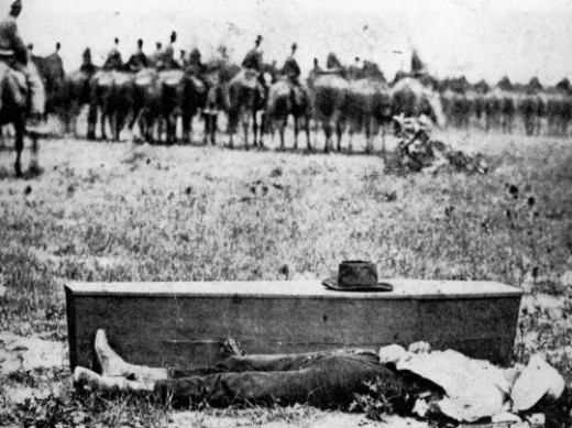 The execution carried out, the Division marches past the body