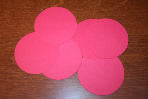 I cut out six circles from two sheets of red cardstock.  Four circles per sheet.