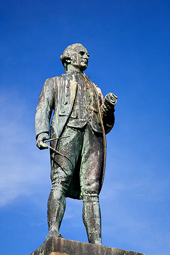 Statue of Captain Cook, West Cliff, Whitby overlooking the harbour he sailed out of as an employee of John Walker the Quaker shipmaster