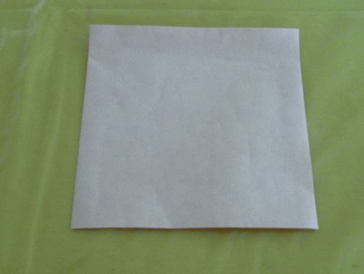 Turn the origami paper over. The other side of the paper should be white colour.