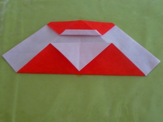 Fold down the flap and align the corner to the bottom folded edge.