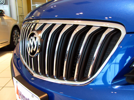 "Buick's signature ""waterfall"" grill marks a distinctive luxury touch to Encore's profile"