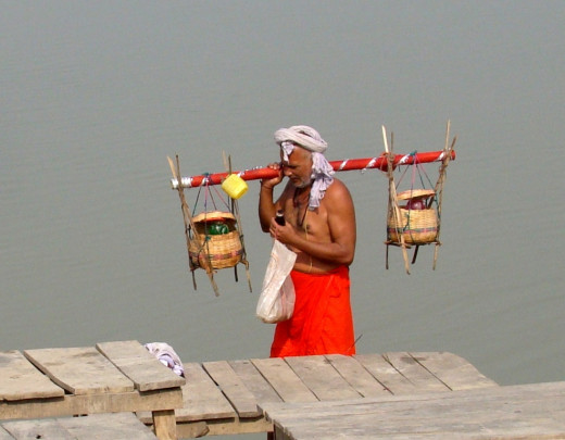 A typical pilgrim carrying Ganga water in pitchers on shoulder