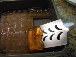 Ease the cut candy out of the pan a few at a time with a metal turner also dipped in hot water; blot off excess water on a paper towel