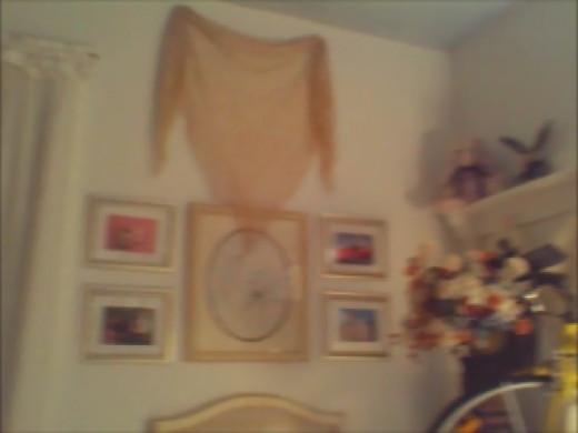 Bird print flanked by BB Bunny framed cards with ecru signature shawl draped above.