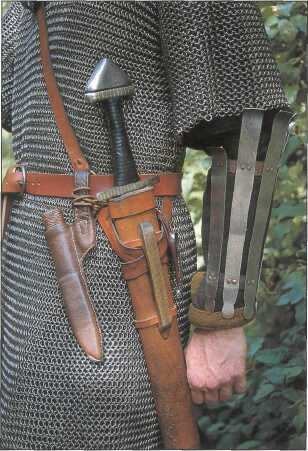 Arm guard and weaponry - the knife seems to be either drawn or missing