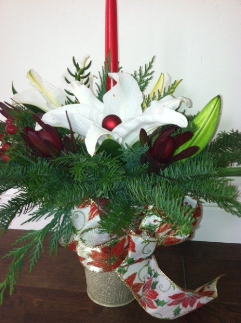 A single bow and a single lily--that's all it takes to make the arrangement pop.