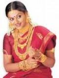 Bride bedecked in Gold Jewellery and Kanjeevaram Silk Saree