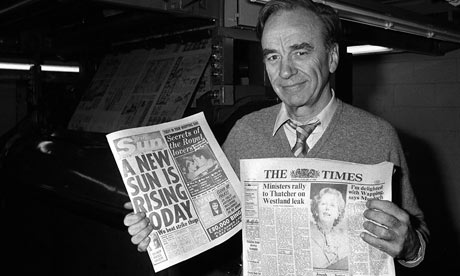 Murdoch brandishes copies of The Times and The Sun - end of an era of shop floor representation and the onset of 'New Technology' (a byword for lowering standards)