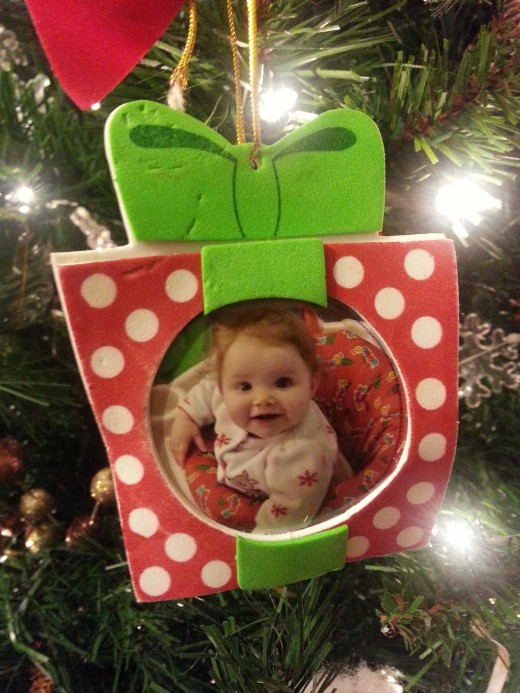 Handmade photo ornament of one of my granddaughters made by a friend.
