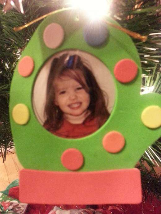 Handmade photo mitten ornament with a photo of my oldest granddaughter.