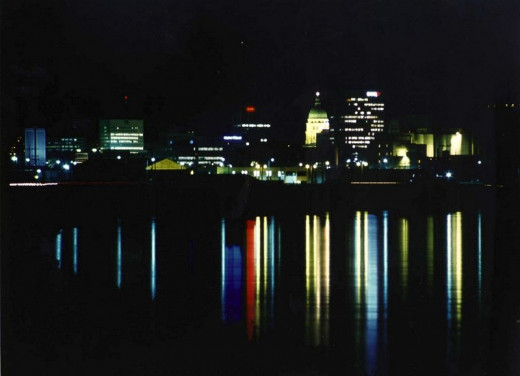 """The nightly skyline of Topeka (Kansas) seems to reflect on the water the colours of Google. The city changed its name into """"Google"""" for the month of March, 2010, to support Google's effort in the fiber experiment."""