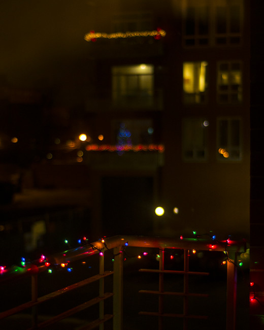 "My holiday lights (front) in focus, neighbor lights had that "" classic"" blur.   iso 200 f/1.8"