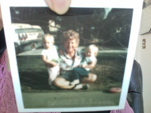 Picture of mom a few years before the fateful night of her visit, with her grand babies.
