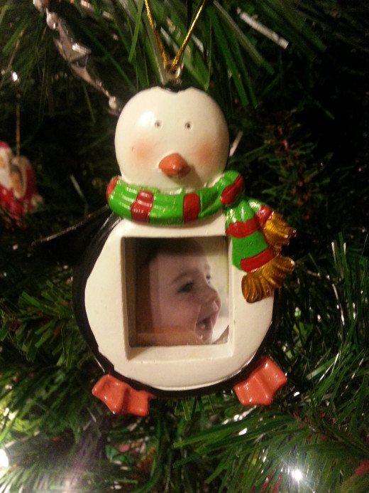 Photo ornament with a photo of my grandson.