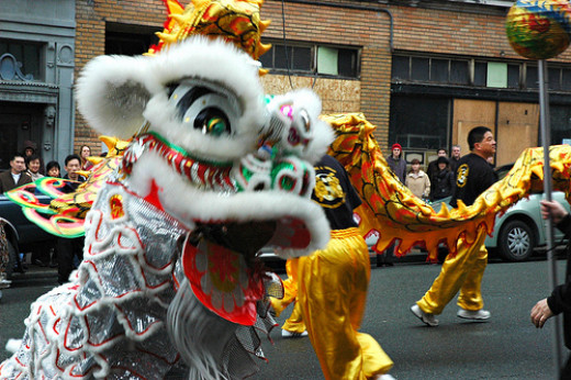 Dancing with a dragon at a Chinese New Year parade.